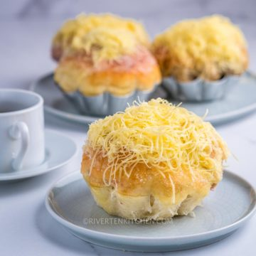 ensaymada with grated cheese on top