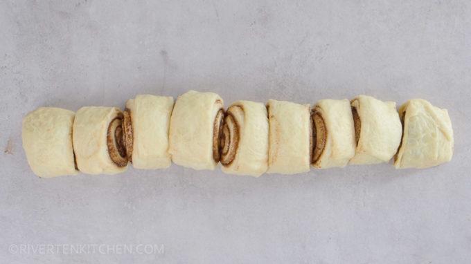cutting cinnamon rolls dough